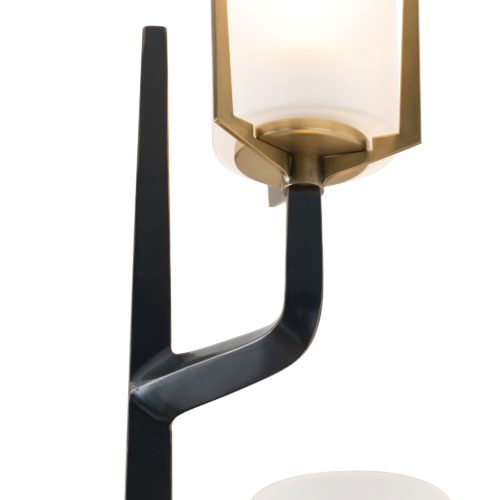 A torch for the new age, this stunning sconce is a unique option for true design enthusiasts seeking something with flair. Frosted glass shades diffuse the light, creating a soft glow that contrasts the sharp angles and bronze finish with antique brass details.