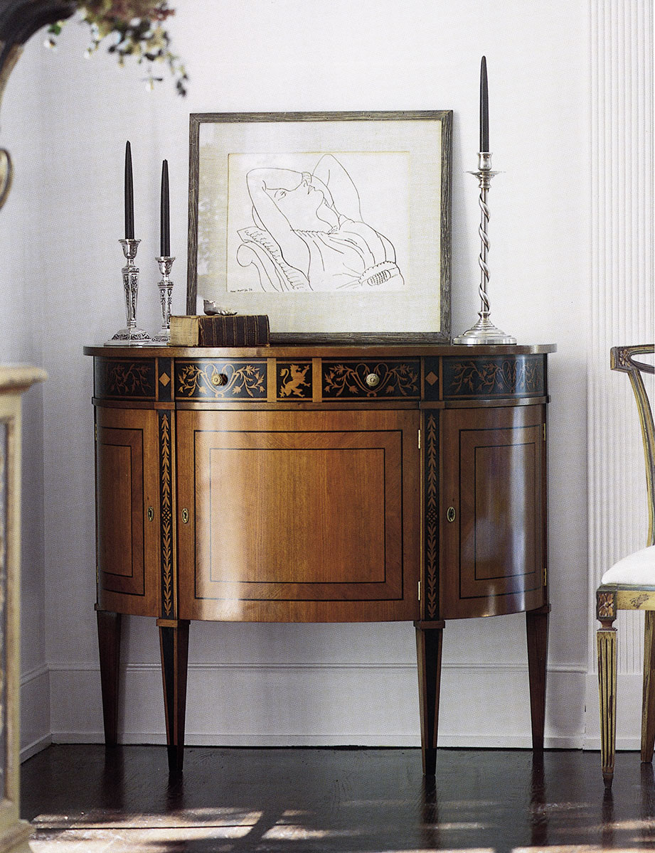 Hand-crafted Louis XVI style half-round cabinet. Cabinet features cherry veneer inlaid with ebony. Louis XVI cabinet has three curved doors with one shelf inside each compartment one drawer and antique brass hardware. This inlaid cabinet is hand-made in Italy.