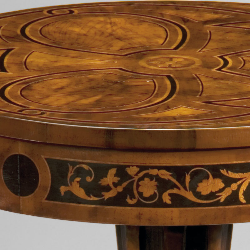 Louis XVI style round wood table. Louis XVI table inlaid with walnut olive burl and boxwood. This occasional table is hand-crafted in Italy; available at InvitingHome.com