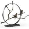 Bird sculpture made from hand wrought iron and a bronze finish on top of a natural black stone base