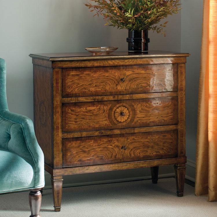 Hand-crafted Neoclassic style inlaid chest. Neoclassic chest features olive burl veneer inlaid with walnut maple and rosewood. This inlaid chest has three drawers heavily antiqued silver trim and antique brass hardware. This inlaid chest is hand-made in Italy.