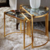 These Art Deco styled nested tables feature acid washed mirror tops on gold leafed finished frames. These tables come as a pair and would make a luxurious addition to any living room