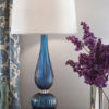 Hand-blown gold and blue Venetian glass lamp. Table lamp has two lights and round hardback fabric shade; max.100 watts each bulb; UL approved; made in Italy
