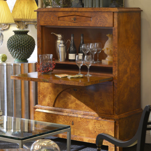 Biedermeier style bar cabinet in poplar burl veneer. Biedermeier style cabinet features drop front and antiqued brass hardware