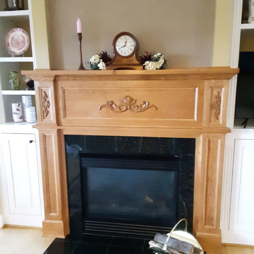 Providence wood carving installation images on a fireplace mantel