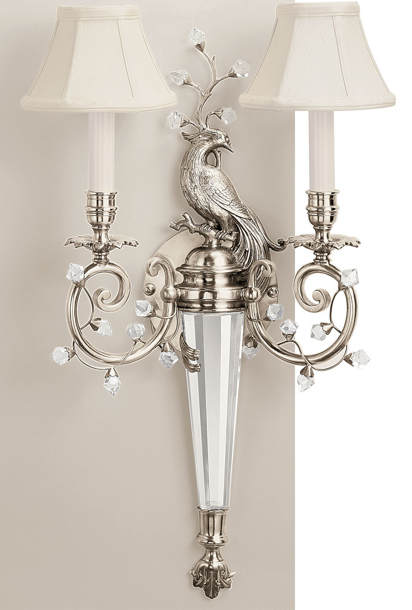 Outstanding quality hand-crafted sconce with peacock motif made of solid brass in lacquered silver-plated finish and solid crystal