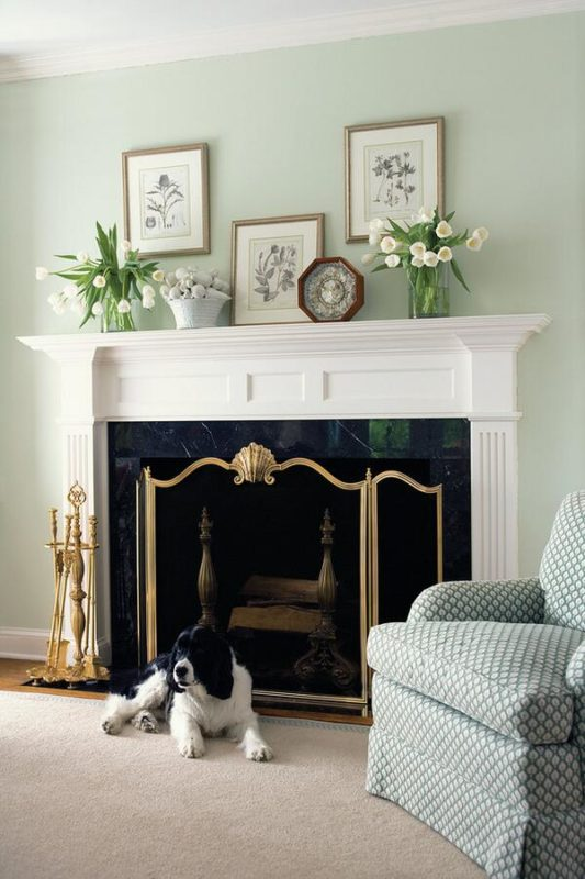 Classic interior with well appointed fireplace mantel; fireplace decorating ideas; interior design inspiration