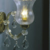 1 light Maria Theresa style crystal sconce with hand-molded arms, frosted crystal components and cut crystal trimmings; all metal parts have gold finish; genuine Czech crystal