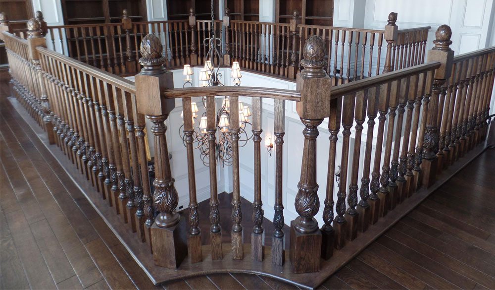 luxury interior with beautiful staircase railing featuring carved wood newels and balusters carved with acanthus leaf design; staircase design ideas; staircase inspiration