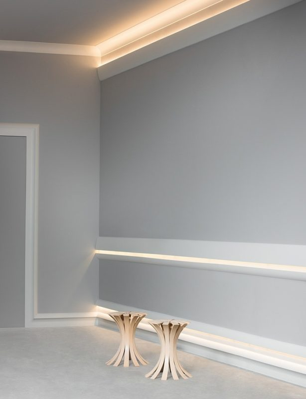 cool application of Calabasas moldings as chair rail, above the baseboard and as cornice for indirect lighting, highlighting Belvedere cove molding; cool molding desigh ideas