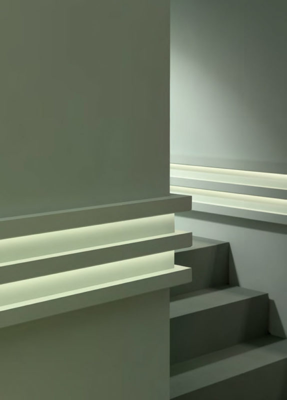cool wall molding ideas; This creative combination of molding for indirect lighting is assembled to create a striking modern wall treatment; modern decor inspiration