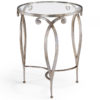 Round hand-wrought iron occasional table with scroll design. Wrought iron table finished in distressed antique silver-leaf and has thick glass top. This hand-wrought iron table is hand-crafted in Italy