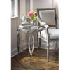 Elegant interior with hand-wrought iron table in antique silver leaf finish; hand-made in Italy; available at InvitingHome.com