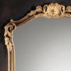 18th-century Tuscan style carved wood mirror with shell, leaf and floral carving. Framed mirror is hand-painted in medium brown finish and antiqued gold-leaf trim. This mirror is hand-crafted in Italy