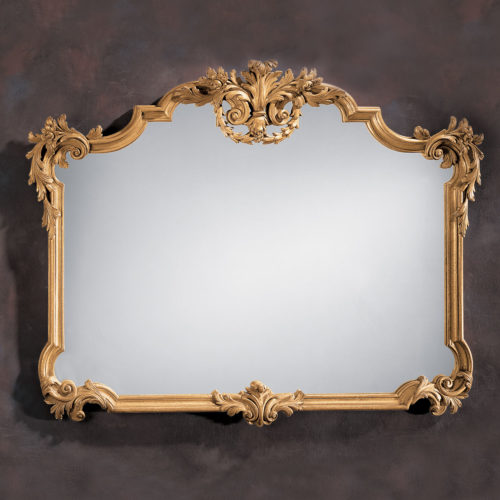 This horizontal wall mirror is hand-crafted in 18th century Tuscan style. Wall mirror has a carved wood frame with floral and leaf scrolls in antiqued hand applied gold metal leaf finish. This Tuscan style mirror is hand-crafted in Italy