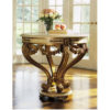 Louis XVI style round carved wood center table with antiqued gold-leaf finish. Louis XVI center table has antiqued ivory trim and Estremoz marble top with curved, beveled edge. This center table is hand made in Italy