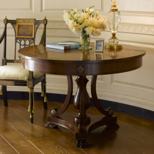Biedermeier style round wood center table with olive and ash burl veneer. Biedermeier center table has walnut trim, antiqued brass accents and carved claw feet. This center table is hand made in Italy