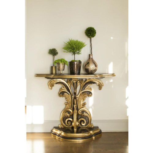 Late Baroque style carved wood console table. Baroque style console has antique brown finish and antique gold leaf trim. This console table is hand made in Italy