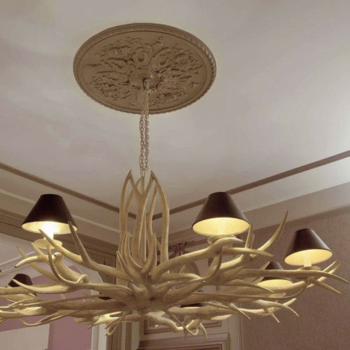 beautiful chandelier with ceiling medallion and panel molding on the ceiling