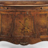 Hand-crafted Transitional style inlaid credenza. This credenza features chestnut and cherry veneer, inlaid musical design on the doors and the top. Transitional credenza has four curved doors, one drawer and antique brass hardware. This inlaid credenza is hand-made in Italy