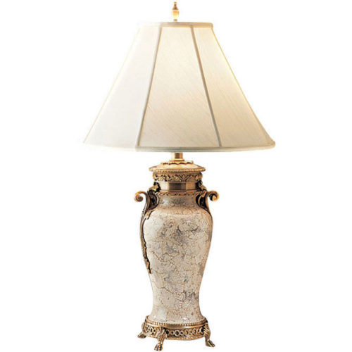 Solid brass table lamp with crackled eggshell finish, urn motif and scrolled arms. Table lamp has an antiqued brass trim and ornamental footed base, round piped fabric shade; max.150 watts