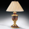 Antiqued solid brass and wood lamp with round pleated fabric shade. This table lamp is designed to accommodate one light bulb