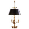 Hand-crafted two-light antiqued solid brass table lamp. Table lamp has a round black-finished brass shade with hand-painted antiqued gold border; for candelabra bulbs, max. 60 watts each bulb