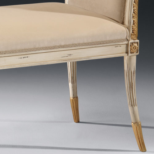 Regency style carved beech wood bench with distressed white finish, antique gold leaf trim and beige upholstery. This bench is hand-crafted in Italy