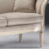 Louis XVI style carved beech wood settee with distressed white finish, antique silver leaf trim and grey upholstery. This settee is hand-crafted in Italy
