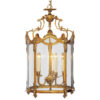 Solid cast brass round Empire lantern in French gold finish. Lantern is hand-crafted with elegant scrolling, shell and leaf motif.