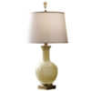 Hand-blown yellow glass lamp with antiqued solid brass trim. Table lamp has round hardback fabric shade;