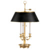 Two-light solid brass table lamp. Table lamp has adjustable round black-finished brass shade and antique finish;