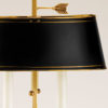 Two-light solid brass table lamp with urn motif. Table lamp has an adjustable oval black finished brass shade and antique finish;