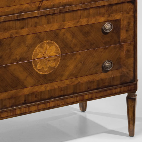 Hand-crafted Maggiolini style inlaid chest. This chest features black walnut veneer inlaid with walnut, olive, boxwood and rosewood. Maggiolini chest has three drawers and antique brass hardware. This inlaid chest is hand-made in Italy