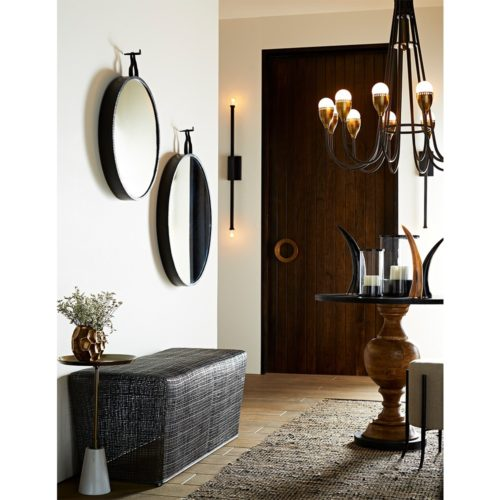 beautiful entryway with natural earth-tone hues and dark iron accents.