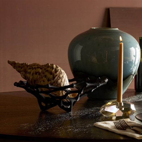 modern decorative accessories featuring antique bronze centerpiece and crystal candle holder.