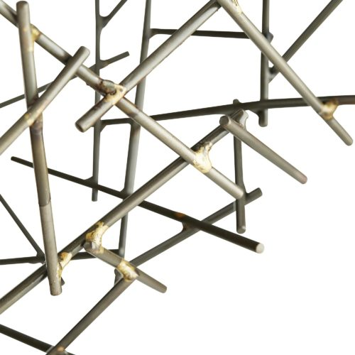 Up close, you can see the global grid made by hundreds of slender, natural iron rods, welded together in contrasting brass adding small hints of gilt shine throughout its complex structure. Adding to its artistic elegance is the four-prong, gold leaf stand.