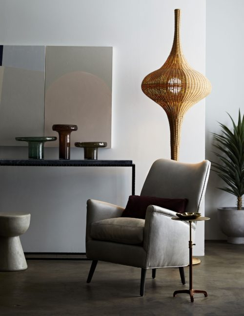 modern style living room with gray accent chair and seedy glass vase set.