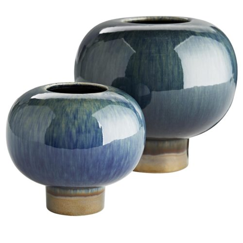 At first glance these vases may look ordinary, though they are anything but. A peacock and bronze reactive glaze breaks over the porcelain ceramic to create a devastatingly beautiful aesthetic.These short and stout vases rest atop a circular platform and are watertight, making them a desirable way to showcase a few bonny blooms.