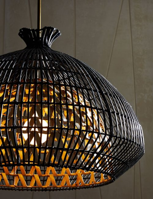 Svelte. Sleek. Sophisticated. This large-scale pendant brings romantic and moody light to a space while showcasing its own curvy and sultry style. It's built with two layers; the interior form is made of naturally finished woven rattan slatson a metal frame and the outer shade is woven with rattan core strips that are finished in black.