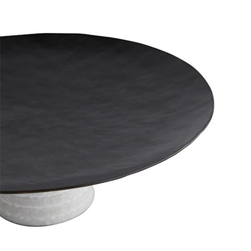 Featuring a deep textural surface, this centerpiece is a focal point when showcased solo and a unique platform for elevating tabletop decor.