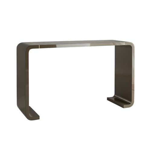 Clean and curvaceous lines define this console's sleek profile. A rich gray lacquer finish brings a luxe shine to the wood frame, while the thin antique brass inlays that lie near the edges elevate its overall sleekness.