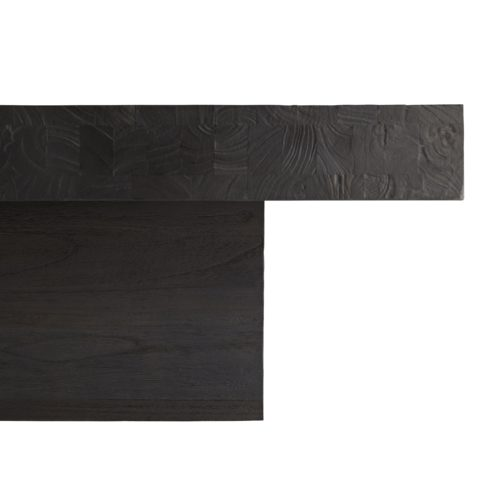 Crafted from blackened wood, which is first sandblasted to give an intense, charred wood finish that you can see and feel. The top uniquelyhas an added brushed texture, and a slight gloss is achieved from a final wax coat, delivering a modern polish. The large-scale top extends over the base to create a floating effect--a great focal point for a contemporary living space.
