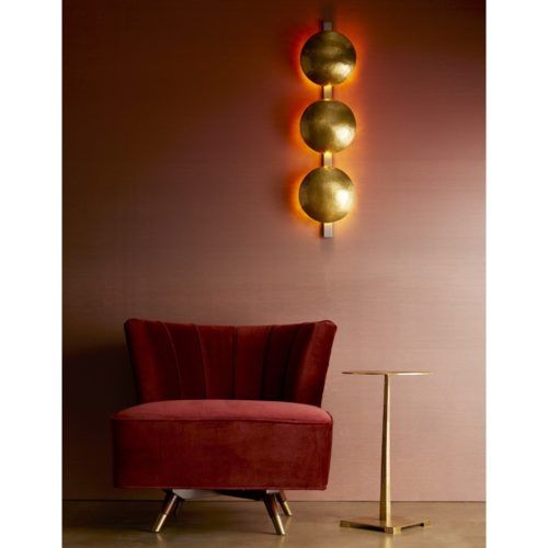 Merlot velvet accent chair is chic and carries a contemporary feel. Beautifully accented with gold side table and unique lighting.