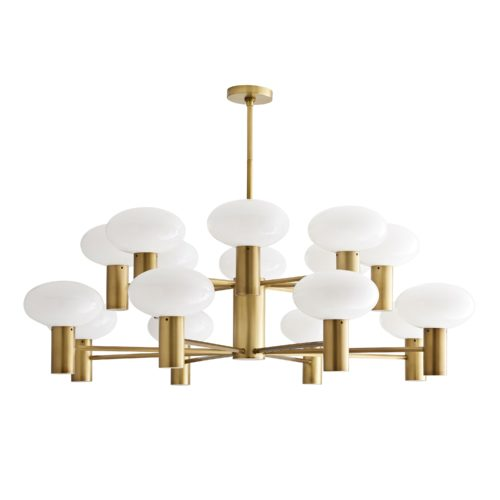 Finished in antique brass, the cylindrical center features several slender arms that spider out in a diamond-like formation to showcase sixteen mushroom-shaped opal glass globes. The connection between the glass and the steel is cleanand concise—visually streamlining this piece. Oversized, this luxe light is a great solution for personal or professional spaces in need of a little (or a lot!) of luster.