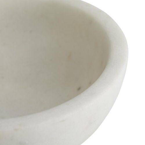 Smooth white marble creates a bowl-shaped form that is showcased on a white marble platform and accented by a thin antique brass belt. Elevates a space instantly, whether in use as a snack bowl or a catchall container.