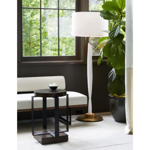 Sleek in form, the slender body is accented by a steelframe, cream finish, wood detail and decorative pull chains. Topped with a white linen drum shade.