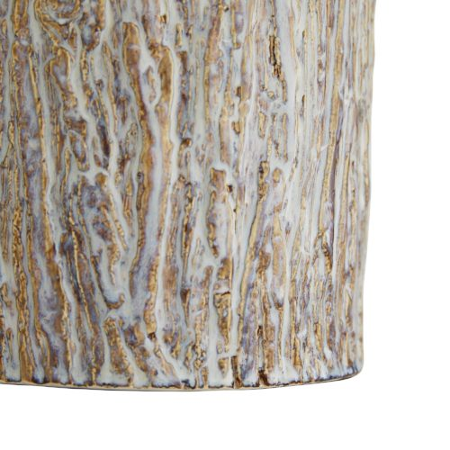 Let this lamp create a natural narrative while offering an organic ambience to your desktop or entryway console. Crafted from ceramic, the cylindrical silhouette of this piece was formed using a mold shaped from an actual tree trunk.The frosted sand dune reactive glaze finish enhances its visual and tangible texture.