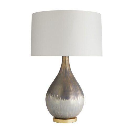 Mercury glass has been used for centuries to create traditional décor pieces. This table lamp features a satin silvered bronze finish that's matte and distressed to give it a handsome, aged look. The process naturally creates drip textures thatmake it even more spectacular—when switched on, it has a rainbow-like iridescent sheen.
