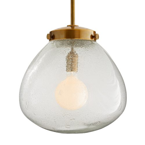 Traditional materials take on classic geometric shapes to create this modern marvel. A single light extends from a brass pipe with an antiqued finish into a clear, seedy glass globe, that when lit accentuates the bubbled texture and softlyilluminates a room. This large-scale piece is a great focal point for modern dining settings or casual contemporary spaces.